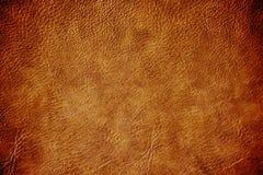 Абстрактное коричневое кожаное lig центра виньетки темного цвета предпосылки Стоковые Фотографии RF