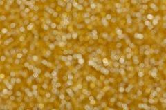 Абстрактное оранжевое bokeh искры яркого блеска Стоковая Фотография