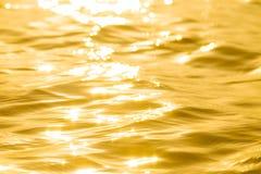 Абстрактное солнечное отражательное поверхностное золото стоковые фото
