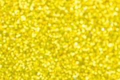 Абстрактное bokeh желтого цвета предпосылки Стоковая Фотография
