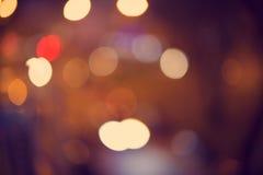 абстрактное bokeh предпосылки Ноча праздника Стоковые Фото