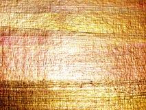 абстрактной рука нарисованная предпосылкой золотистая Стоковое Изображение