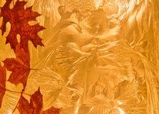Абстрактные листья падения на текстурированной оранжевой предпосылке Стоковые Фото