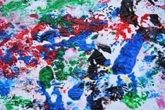 Абстрактные пастельные голубые розовые красные голубые темные цвета и оттенки Абстрактная влажная предпосылка краски Пятна картин стоковая фотография