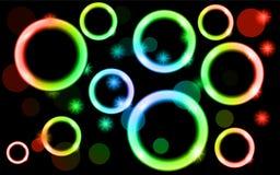 Абстрактные, пестротканые, неоновые, сияющие, яркие, накаляя круги, шарики, пузыри, светлые пятна с звездами на черной предпосылк Стоковое Фото