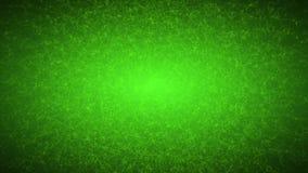 Абстрактные пропуская частицы на зеленой предпосылке видеоматериал