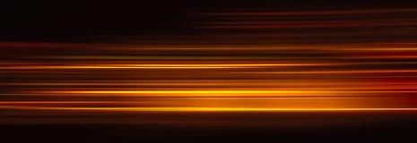 Абстрактные следы красного света в темной предпосылке Стоковое фото RF