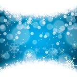 Абстрактные снежинки сини зимы Стоковая Фотография