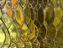 Абстрактные стекло и свет цвета желтого цвета предпосылки Стоковое Изображение