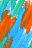 Абстрактные ходы предпосылки сини, апельсина и зеленого цвета краски Стоковые Изображения RF