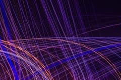 Абстрактные яркие пестротканые накаляя линии и кривые стоковые изображения rf