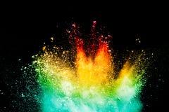 Абстрактный взрыв порошка цвета на черной предпосылке Стоковое Изображение