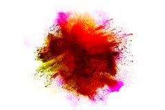 Абстрактный взрыв пыли красно-апельсина на белой предпосылке Стоковое фото RF