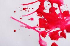 Абстрактный выплеск краски акварели на бумажной текстуре Стоковое Фото