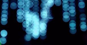 абстрактный голубой свет на темной предпосылке Стоковое фото RF