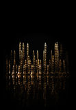 Абстрактный город винтов на черной предпосылке Стоковые Фотографии RF
