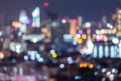 Абстрактный город bokeh освещает предпосылку Стоковые Фото