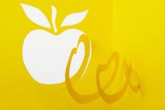 абстрактный желтый цвет бумаги выреза яблока Стоковое Фото