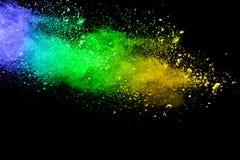 Абстрактный зеленый взрыв пыли на черной предпосылке Стоковая Фотография