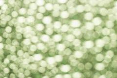 Абстрактный зеленый цвет запачкал предпосылку bokeh от падений воды Стоковое Фото