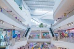 Абстрактный интерьер торгового центра и универмага нерезкости Стоковые Изображения