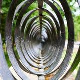 Абстрактный состав колец металла черноты Стоковые Фотографии RF