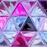 Абстрактный состав лилий с предпосылкой цветного стекла треугольника в ультрафиолетов и голубых цветах Стоковое фото RF