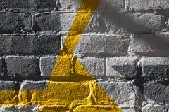 Абстрактным желтым стена покрашенная серым цветом Стоковая Фотография