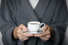 давать кофейной чашки Стоковое фото RF
