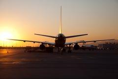 Авиапорт во время захода солнца Стоковая Фотография