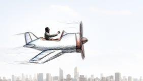 Авиатор в плоскости ретро  Мультимедиа Стоковое Изображение RF