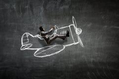 Авиатор в плоскости ретро  Мультимедиа Стоковое Фото