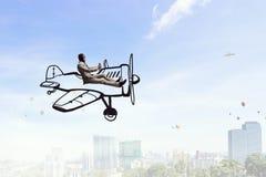 Авиатор в плоскости ретро  Мультимедиа Стоковая Фотография
