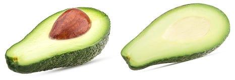 Авокадо 2 отрезанный в половине при сделанные ямки ямы, стоковые фото