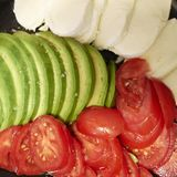 Авокадо, томаты и сыр моццареллы Стоковое Изображение