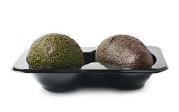 2 авокадоа в пластичном случае Стоковая Фотография