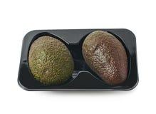 2 авокадоа в пластичном случае Стоковые Изображения