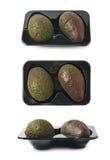 2 авокадоа в пластичном случае Стоковое Фото
