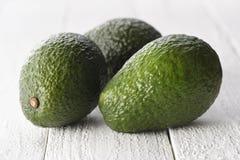Авокадоы на белой предпосылке Стоковое фото RF
