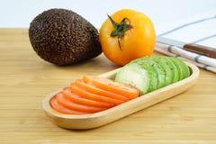 Авокадо и томат Стоковое Изображение RF