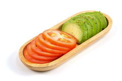 Авокадо и томат Стоковые Фотографии RF