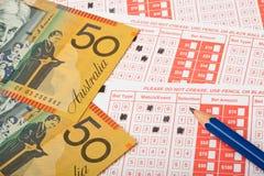 Австралийские деньги и выскальзывание спорт держа пари Стоковые Изображения