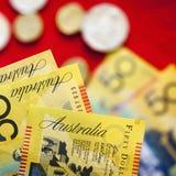 Австралийские деньги над красной предпосылкой Стоковое Изображение RF
