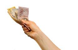 Австралийские доллары в руке Стоковые Фотографии RF