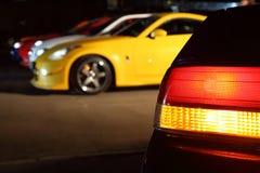 автомобили покрасили multi стоянку автомобилей номера Стоковые Фотографии RF