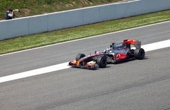 автомобили 1 обходят вокруг участвовать в гонке формулы Стоковые Фотографии RF