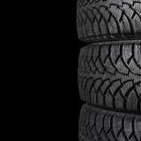 Автомобильная шина на черноте Стоковые Фотографии RF