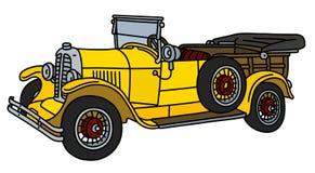 Автомобиль винтажного желтого цвета открытый Стоковые Изображения RF