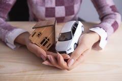 Автомобиль дома коммерсантки стоковое изображение