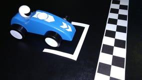 Автомобиль игрушки на начинать решетку Стоковые Фото
